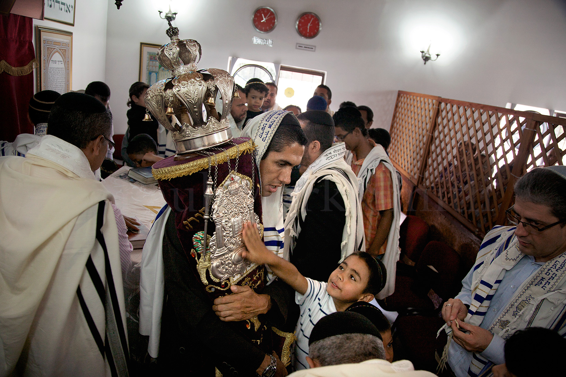 Evangelical Christian converts to Judaism with a 120 year old Torah in a synagogue in Bello, Colombia
